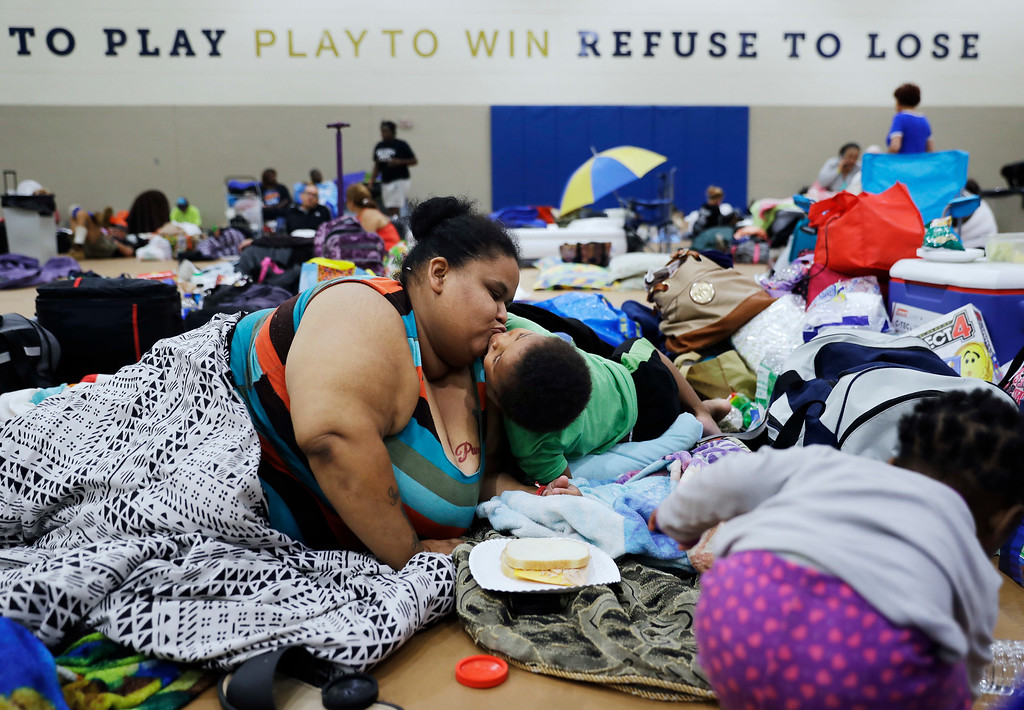 . Annette Davis kisses her son Darius, 3, while staying at a shelter in Miami after evacuating from their home in Florida City, Fla., ahead of Hurricane Irma Saturday, Sept. 9, 2017. (AP Photo/David Goldman)