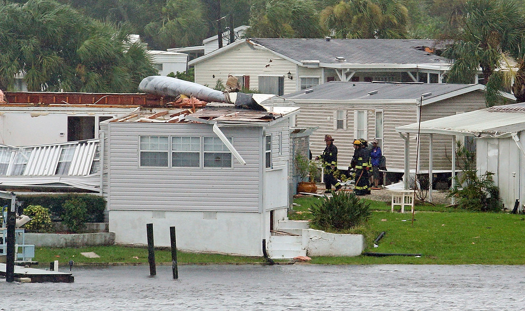 . Palm Bay fire fighters go house to house after a possible tornado touched down at Palm Palm Bay Estates Sunday, Sept. 10, 2017 as Hurricane Irma made landfall in the state of Florida. (Red Huber/Orlando Sentinel via AP)