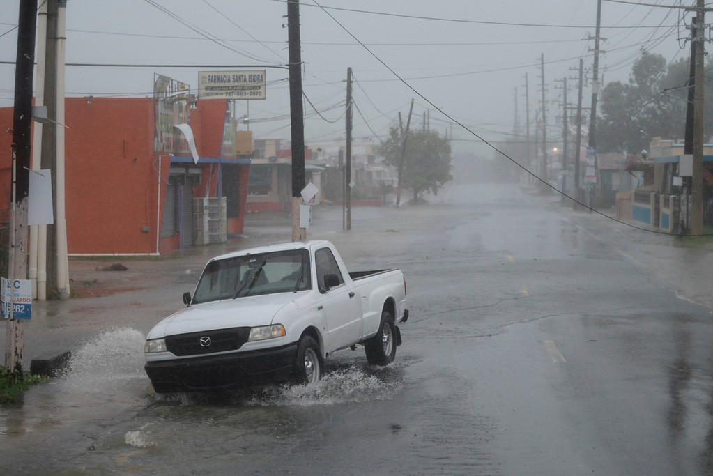 . A man drives through rain and strong winds during the passage of hurricane Irma, in Fajardo, Puerto Rico, Wednesday, Sept. 6, 2017. The US territory was first to declare a state of emergency las Monday, as the National Hurricane Center forecast that the storm would strike the Island Wednesday. (AP Photo/Carlos Giusti)