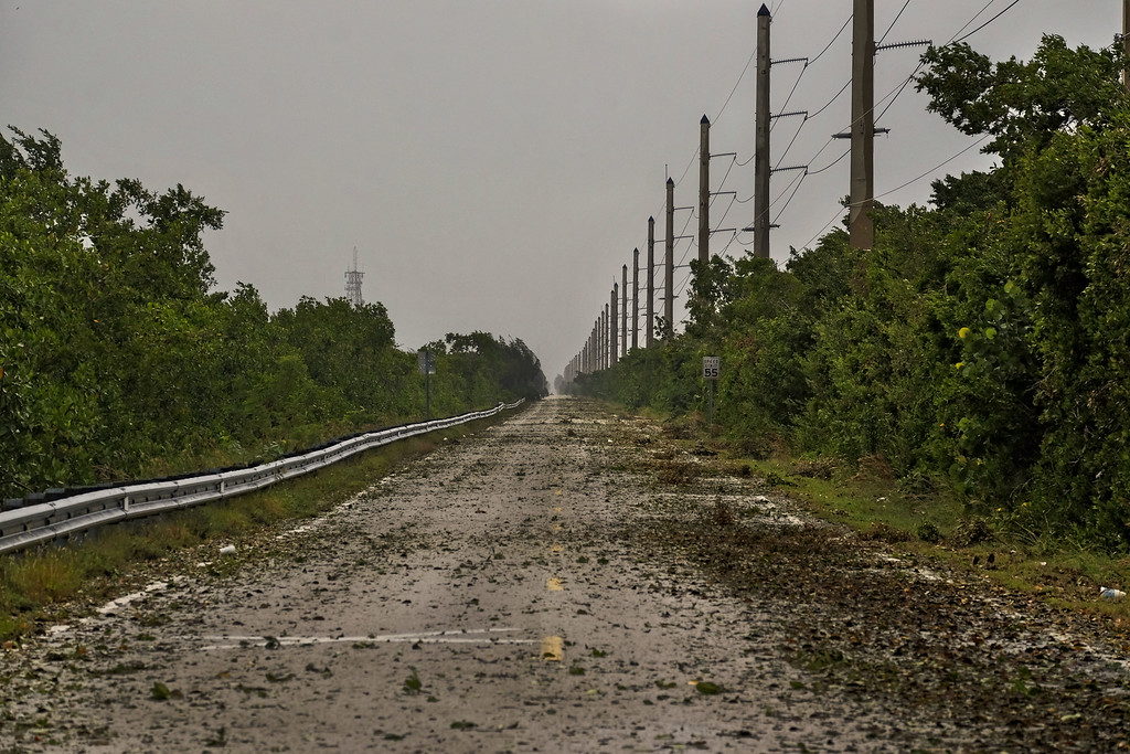 . Debris litter Cardsound Road into the Florida Keys as winds and rain from the outer bands of Hurricane Irma arrive in Key Largo, Florida on September 9, 2017. The number of people in the US state of Florida under orders to evacuate in the face of approaching Hurricane Irma has climbed to 6.3 million, authorities said. (GASTON DE CARDENAS/AFP/Getty Images)