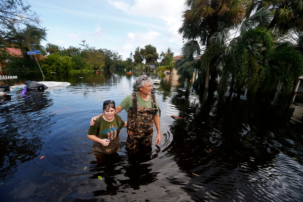 . Kelly McClenthen returns to see the flood damage to her home with her boyfriend Daniel Harrison in the aftermath of Hurricane Irma in Bonita Springs, Fla., Monday, Sept. 11, 2017. (AP Photo/Gerald Herbert)