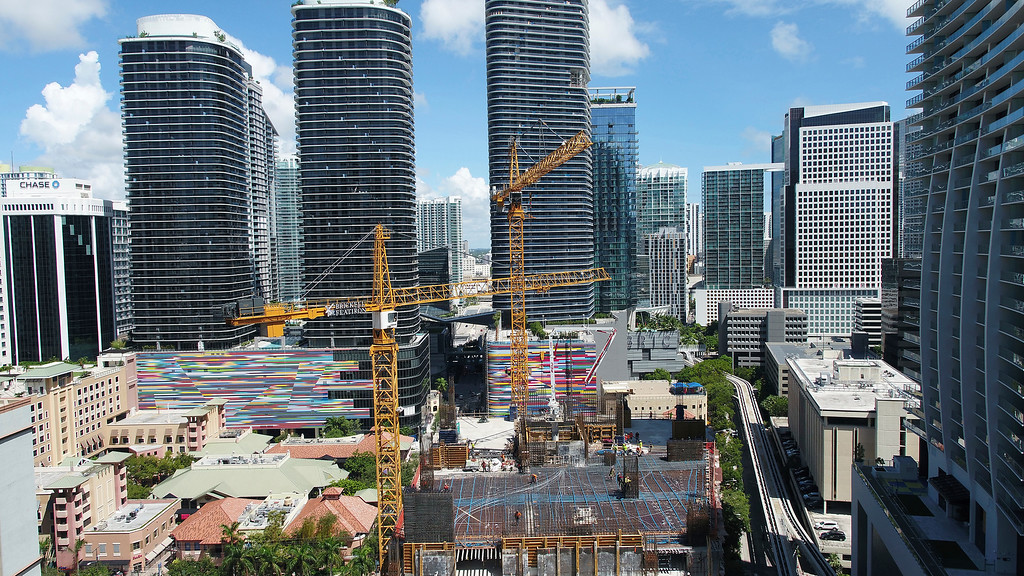 . The Miami skyline is seen in this aerial view with cranes, Thursday, Sept. 7, 2017, in Miami. As Hurricane Irma threatens to pound Miami with winds of mind-boggling power, a heavyweight hazard looms over the city\'s skyline: two dozen enormous construction cranes.(DroneBase via AP)