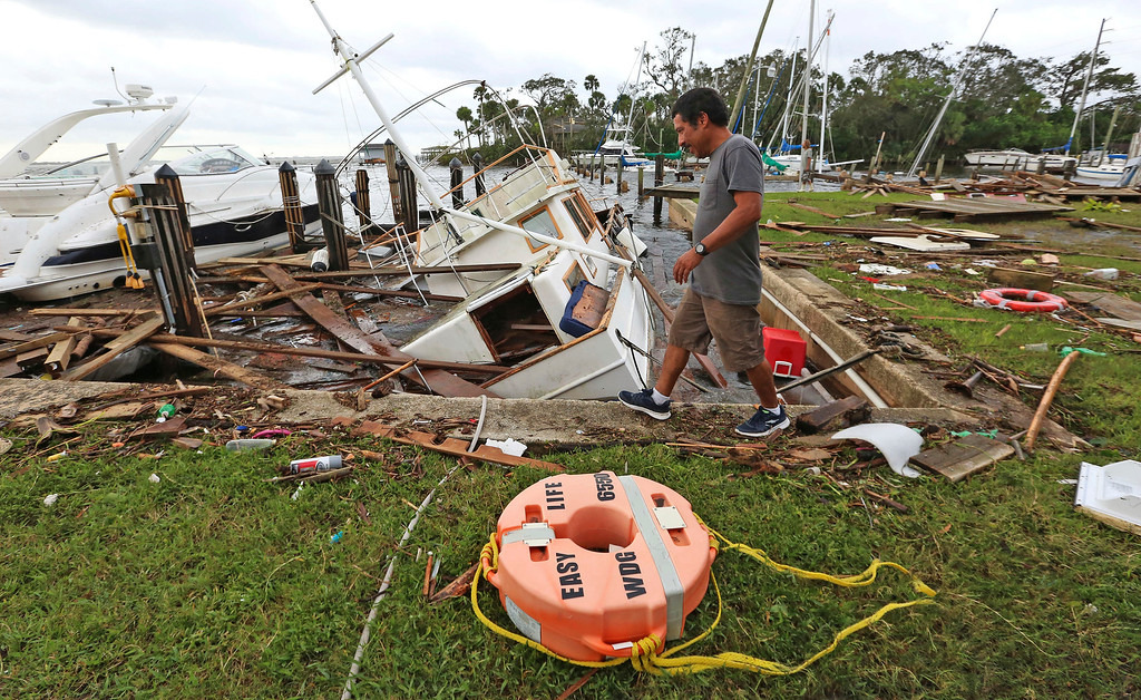 . A man walks by damage from Hurricane Irma at Sundance Marine in Palm Shores, Fla., Monday, Sept. 11, 2017 (Red Huber/Orlando Sentinel via AP)