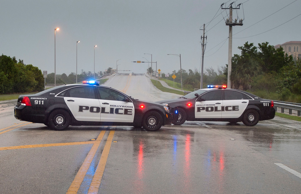 . Police block a road leading to the ocean front in Hollywood, Fla., Saturday, Sept. 9, 2017, as Hurricane Irma approaches the state. (Paul Chiasson/The Canadian Press via AP)