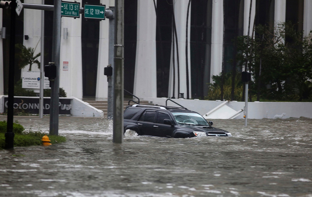 . A vehicle drives on flooded Brickell Avenue in Miami on Sunday, Sept. 10, 2017, as Hurricane Irma passes. (Mike Stocker/South Florida Sun-Sentinel via AP)