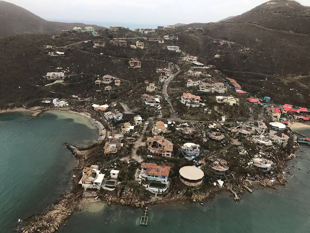. This photo shows storm damage in the aftermath of Hurricane Irma in Virgin Gorda\'s Leverick Bay in the British Virgin Islands, Friday, Sept. 8, 2017. Irma scraped Cuba\'s northern coast Friday on a course toward Florida, leaving in its wake a ravaged string of Caribbean resort islands strewn with splintered lumber, corrugated metal and broken concrete. (Caribbean Buzz Helicopters via AP)