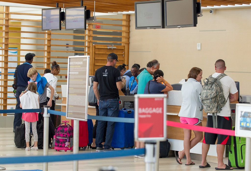 . A few remaining travelers check in and clear United States Customs and Immigration prior to boarding flights to the U.S. mainland, ahead of Hurricane Irma, at the Lynden Pindling International Airport in Nassau, Bahamas, Thursday, Sept. 7, 2017. The airport closed its doors before the end of the day. Forecasters say the Category 5 hurricane has top sustained winds of 175 mph (280 kph) and is expected to remain powerful for the next couple of days. (AP Photo/Tim Aylen)