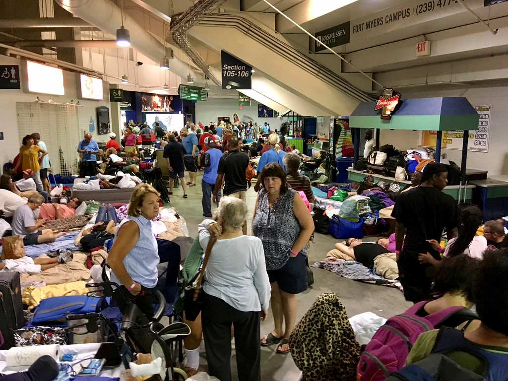 . Evacuees fill Germain Arena, which is being used as a fallout shelter, in advance of Hurricane Irma, in Estero, Fla., Saturday, Sept. 9, 2017. (AP Photo/Jay Reeves)