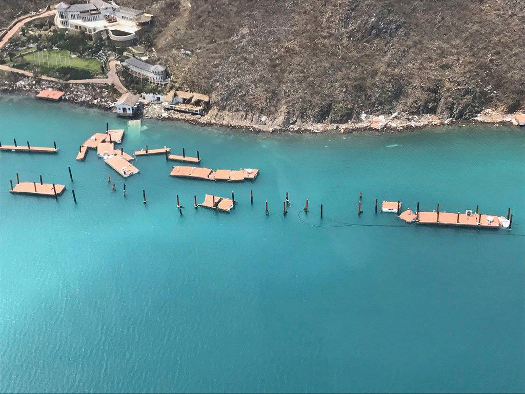 . This photo provided on Friday, Sept. 8, 2017, shows the docks damaged by Hurricane Irma at Virgin Gorda\'s Yacht Club Costa Smeralda in the British Virgin Islands. Irma scraped Cuba\'s northern coast Friday on a course toward Florida, leaving in its wake a ravaged string of Caribbean resort islands strewn with splintered lumber, corrugated metal and broken concrete. (Caribbean Buzz Helicopters via AP)