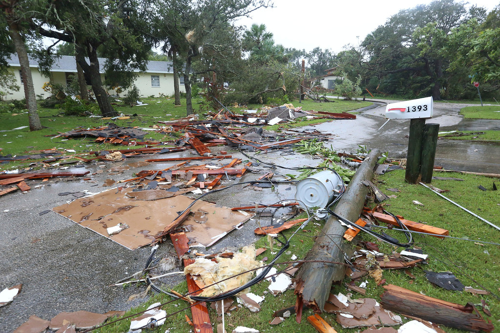 . Debris from a second story roof is scattered over a two-block area after a possible tornado touched down at Palm Bay Point subdivision Sunday, Sept. 10, 2017, in Palm Bay, Fla., as hurricane Irma made landfall in the state of Florida. (Red Huber/Orlando Sentinel via AP)