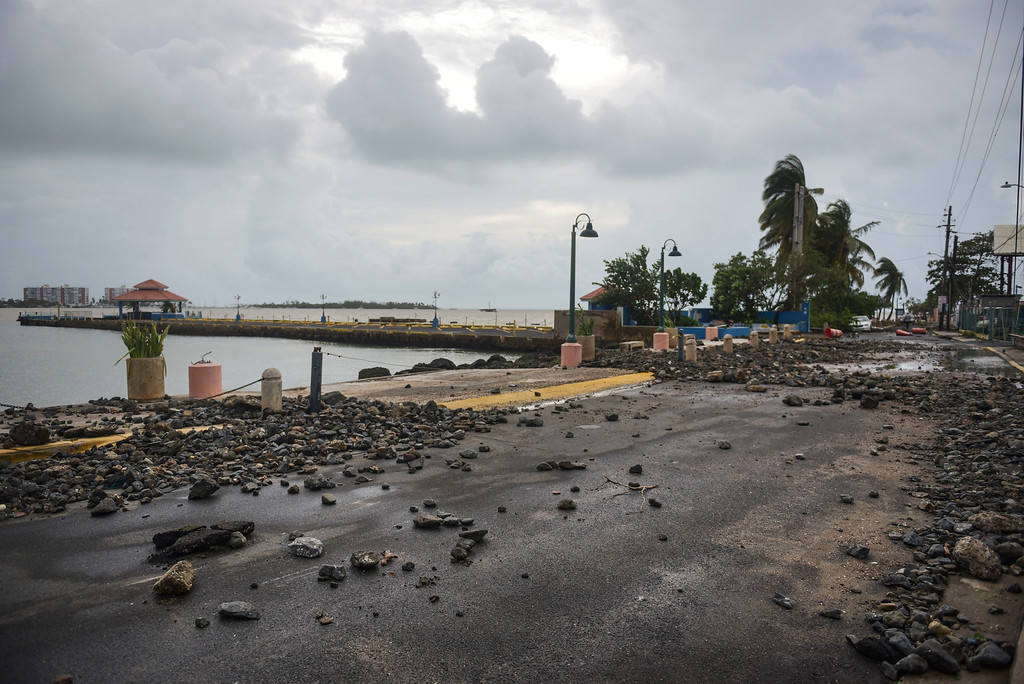 . Rocks are scattered on a road in the aftermath of Hurricane Irma, in Fajardo, Puerto Rico, Thursday, Sept. 7, 2017. Irma cut a path of devastation across the northern Caribbean, leaving at least 10 dead and thousands homeless after destroying buildings and uprooting trees. More than 1 million people in Puerto Rico are without power. (AP Photo/Carlos Giusti)