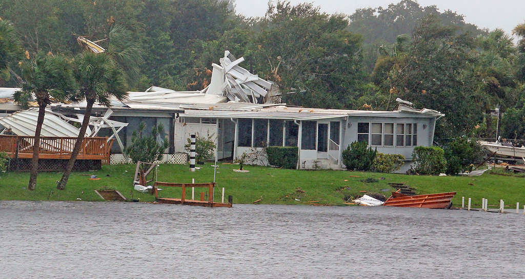. A mobile homes is damaged after a possible tornado touched down at Palm Bay Estates in Palm Bay, Fla., Sunday, Sept. 10, 2017, as Hurricane Irma made landfall in the state of Florida (Red Huber/Orlando Sentinel via AP)