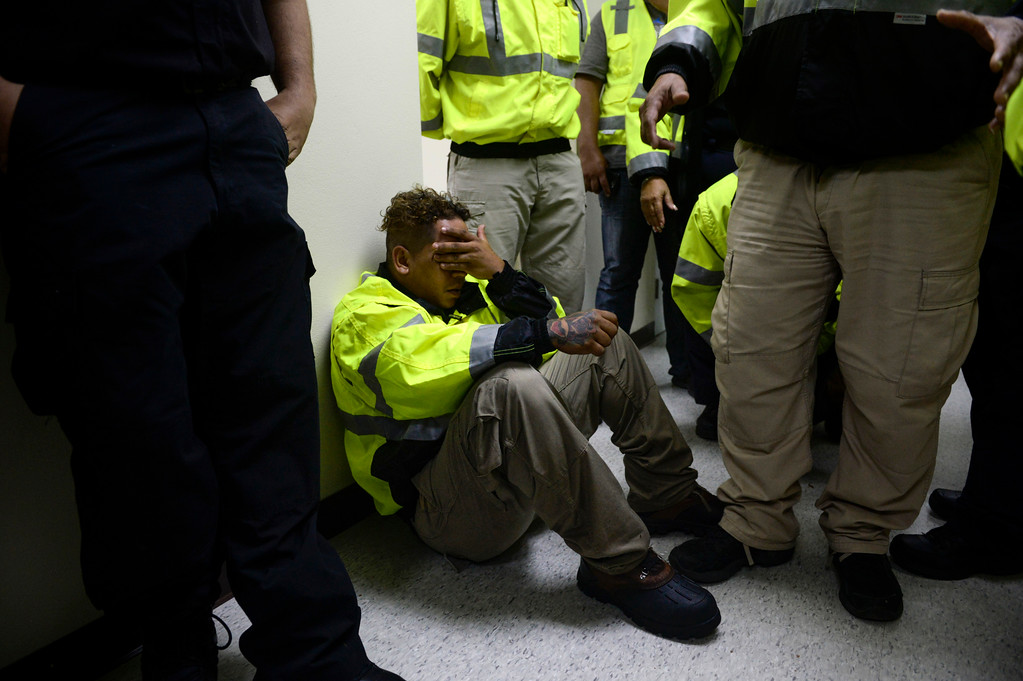 . Rescue team member Jonathan Cruz cries on the floor as he waits to assist in the aftermath of Hurricane Maria in Humacao, Puerto Rico, Wednesday, Sept. 20, 2017. (AP Photo/Carlos Giusti)