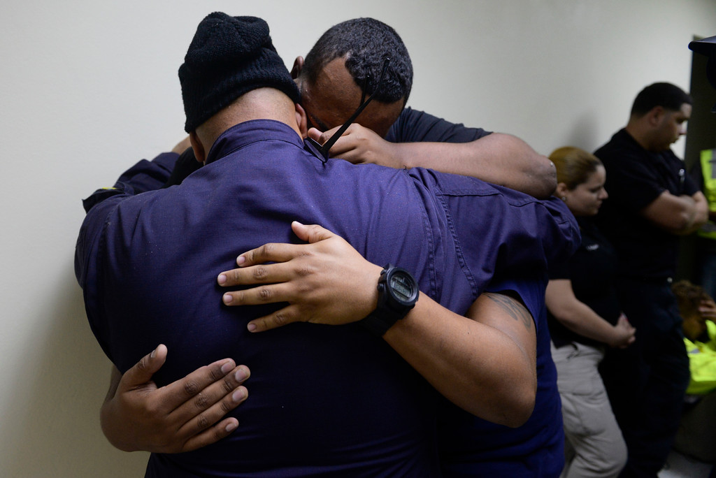 . Members of a rescue team embrace as they wait to assist in the aftermath of Hurricane Maria in Humacao, Puerto Rico, Wednesday, Sept. 20, 2017. (AP Photo/Carlos Giusti)