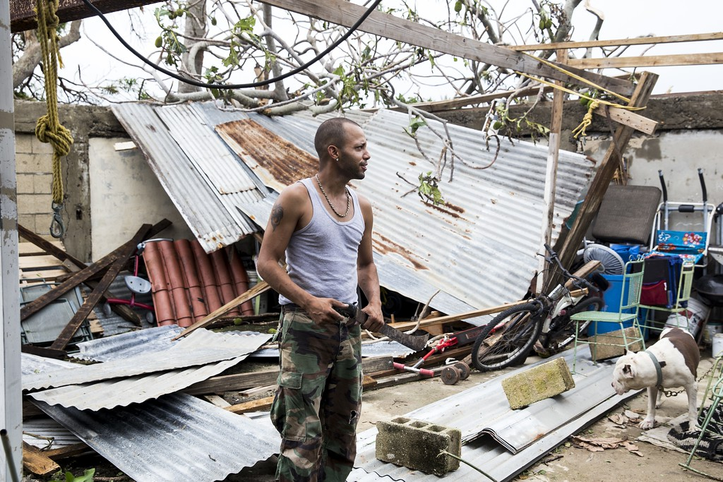 ". SAN JUAN, PUERTO RICO - SEPTEMBER 21: Gabriel Ortega, 29, surveys the damage on his property after Hurricane Maria made landfall, September 21, 2017 in San Juan, Puerto Rico. The majority of the island has lost power, in San Juan many are left without running water or cell phone service, and the Governor said Maria is the ""most devastating storm to hit the island this century.\"" (Photo by Alex Wroblewski/Getty Images)"