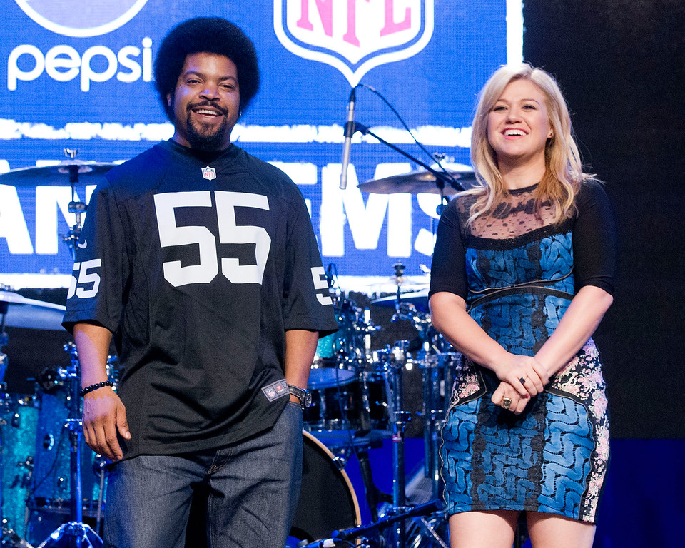 . Ice Cube and Kelly Clarkson attend the Pepsi NFL anthems kick off at Hard Rock Cafe on September 4, 2012 in New York City. (Photo by Dario Cantatore/Invision/AP)