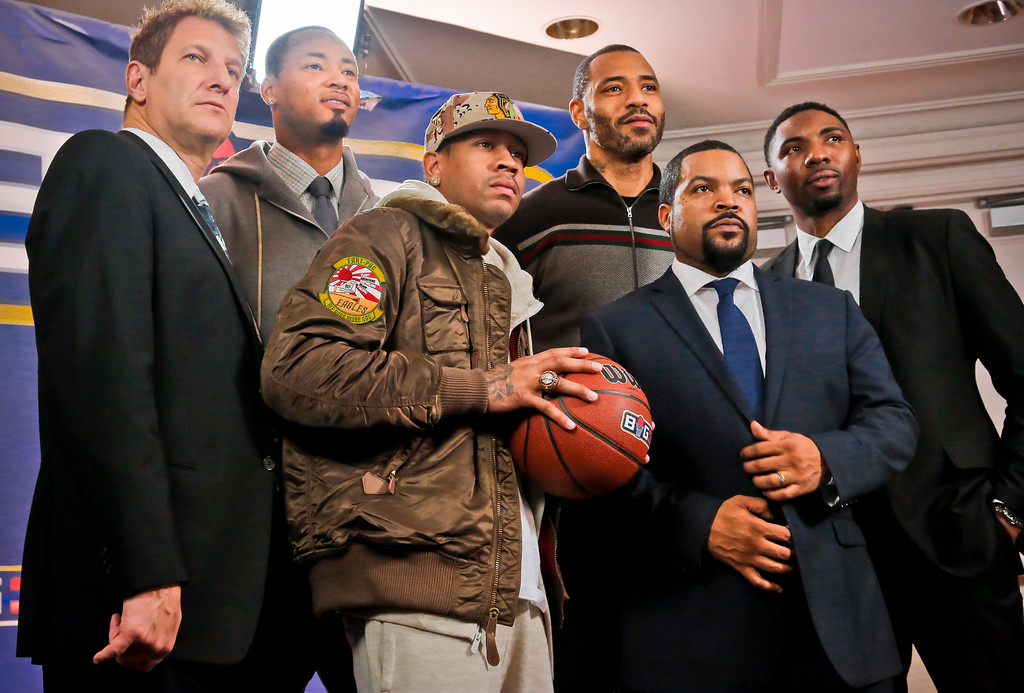 . Entertainment executive Jeff Kwatinetz, far left, and entertainer Ice Cube, second from right, pose with former NBA players Kenyon Martin, second from left, Allen Iverson, third from left, Rashard Lewis, third from right, and Roger Mason, far right, after a press conference announcing the launch of BIG3, a new 3-on-3 professional basketball league, in New York, Wednesday, Jan. 11, 2017.  (AP Photo/Bebeto Matthews)