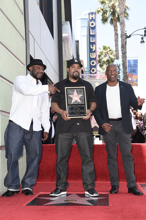. WC, from left, Ice Cube and John Singleton attend a ceremony honoring Ice Cube with a star on the Hollywood Walk of Fame on Monday, June 12, 2017, in Los Angeles. (Photo by Richard Shotwell/Invision/AP)