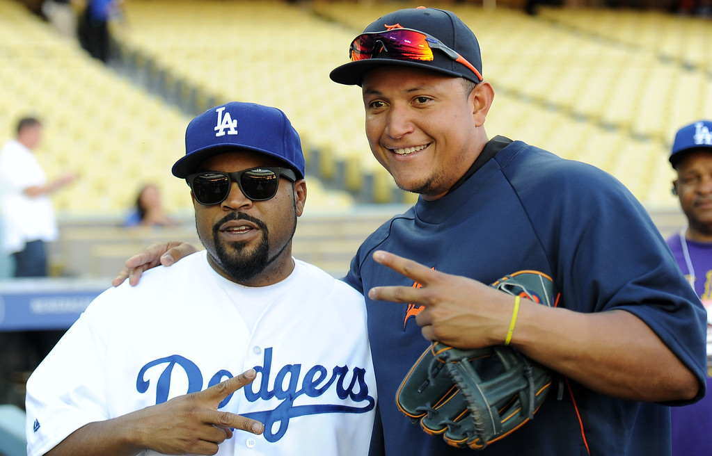 . Performer Ice Cube, left, pose for a picture with Detroit Tigers\' Miguel Cabrera prior to a baseball game against the Los Angeles Dodgers on Tuesday, April 8, 2013 in Los Angeles.   (Keith Birmingham/Pasadena Star-News)