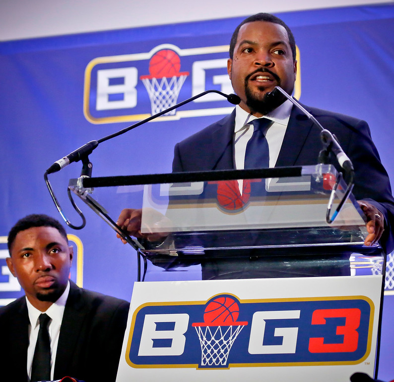 . Former NBA player and players union deputy Roger Mason, left, listens as entertainer Ice Cube, right, announces the launch of the BIG3, a new 3-on-3 professional basketball league, in New York, Wednesday, Jan. 11, 2017.  (AP Photo/Bebeto Matthews)