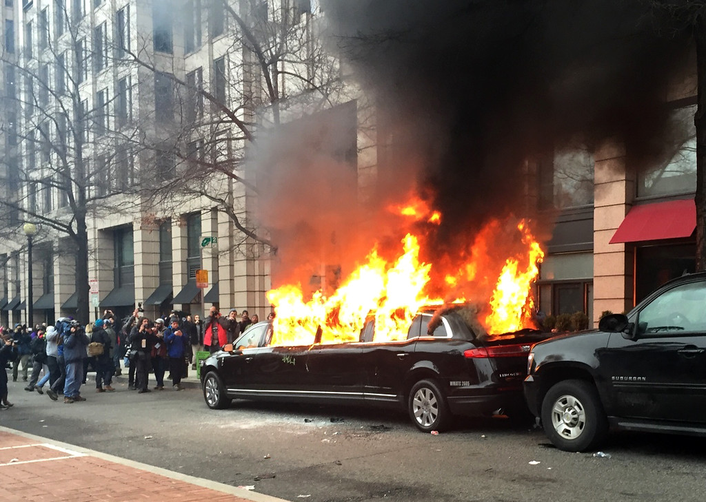 . Protesters set a parked limousine on fire in downtown Washington, Friday, Jan. 20, 2017, during the inauguration of President Donald Trump. Protesters registered their rage against the new president Friday in a chaotic confrontation with police who used pepper spray and stun grenades in a melee just blocks from Donald Trump\'s inaugural parade route. Scores were arrested for trashing property and attacking officers. (AP Photo/Juliet Linderman)