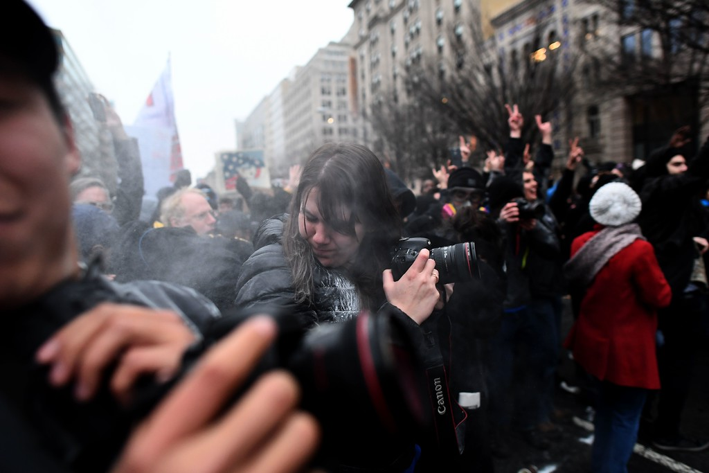 . A woman gets hit with a paintball fired by police during clashes with police in Washington, DC, on January 20, 2107.   Masked, black-clad protesters carrying anarchist flags smashed windows and scuffled with riot police Friday in downtown Washington, blocks away from the route of the parade in honor of newly sworn-in President Donald Trump. (JEWEL SAMAD/AFP/Getty Images)