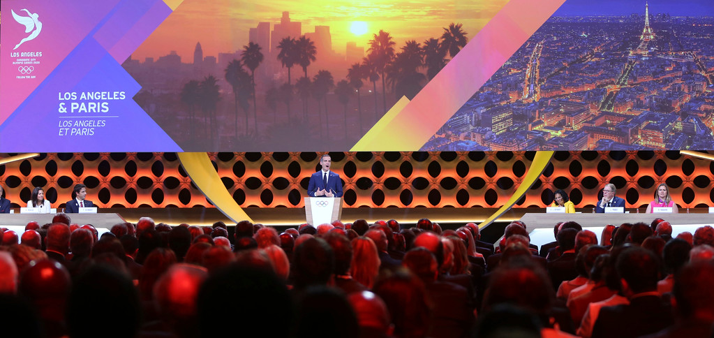 . Los Angeles Mayor Eric Garrett speaks during the IOC session in Lima, Peru, Wednesday, Sept. 13, 2017. The IOC is voting to ratify Los Angeles as the host city of the 2028 Olympic and Paralympic Games and Paris as the host city of the 2024 Games. (AP Photo/Martin Mejia)