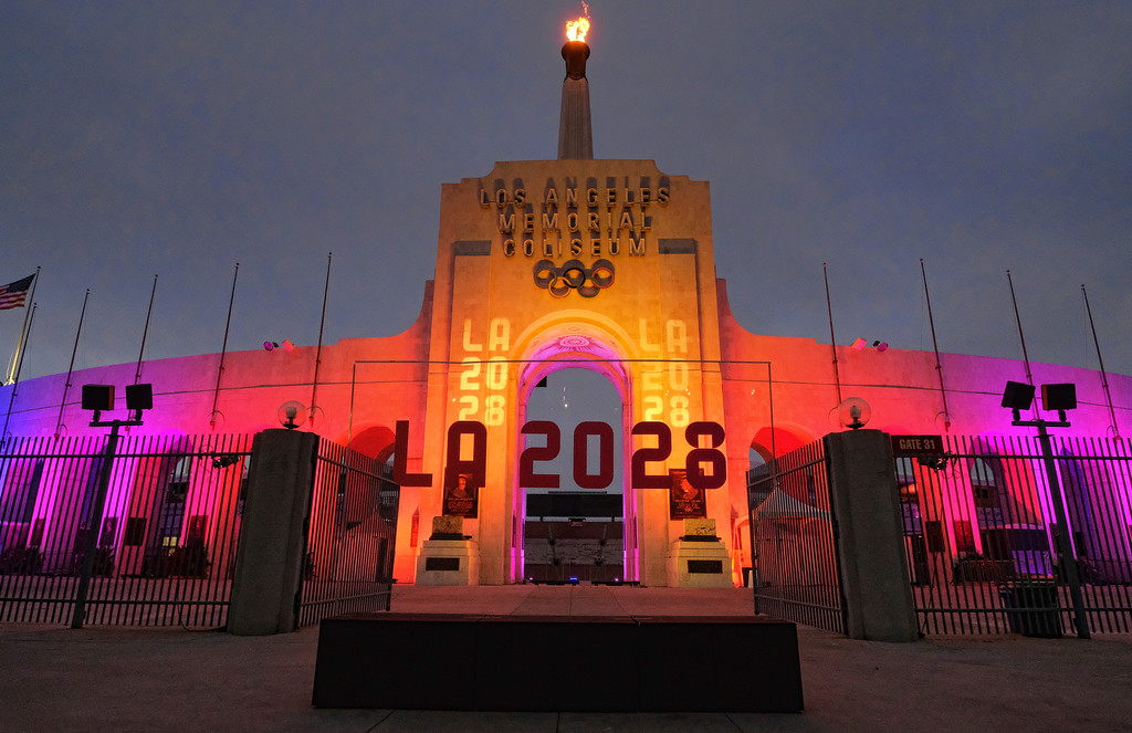 . A blazing Olympic cauldron is seen at the Los Angeles Memorial Coliseum on Wednesday, Sept. 13, 2017. The cauldron was lit early Wednesday morning at the stadium that was the site of the 1932 and 1984 Olympics. An International Olympic Committee meeting in Peru is to make it official that LA will host in 2028 and that the 2024 Games will go to Paris. (AP Photo/Richard Vogel)