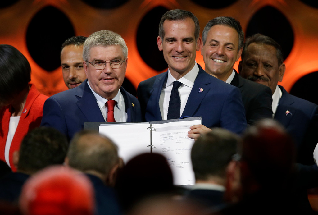 . International Olympic Committee President Thomas Bach (IOC), left, poses with Los Angeles Mayor Eric Garrett at the end of an IOC session in Lima, Peru, Wednesday, Sept. 13, 2017. The IOC is voting to ratify Los Angeles as the host city of the 2028 Olympic and Paralympic Games and Paris as the host city of the 2024 Games during the IOC Session. (AP Photo/Martin Mejia)