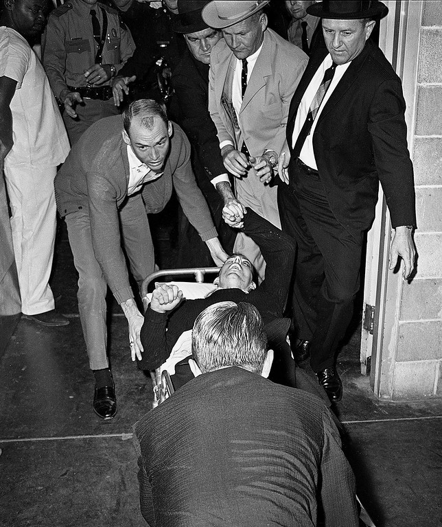 . Lee Harvey Oswald, accussed assassin of President John F. Kennedy, is rushed into Parkland Hospital in Dallas, Nov. 24, 1963.  Nightclub owner Jack Ruby shot and killed Oswald as he was being transferred through the city jail\'s underground garage. Parkland Hospital also treated President Kennedy\'s fatal wounds two days earlier.  (AP Photo/Ted Powers)