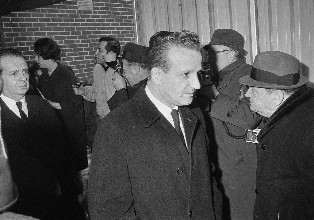 . Two brothers of Jack Ruby, slayer of Lee Harvey Oswald, Sam, left, and Earl, right, leave a Chicago funeral home following services for Jack Jan. 6,  1967, who died in Dallas. (AP Photo/Charles Knoblock)