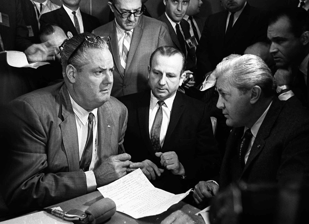 . Jack Ruby, center, the man who shot John F. Kennedy\'s assassin, Lee Harvey Oswald, confers with his attorneys Melvin Belli, right, and Joe Tonahill, left, in District Court in Dallas Jan. 20, 1964.  (AP Photo)