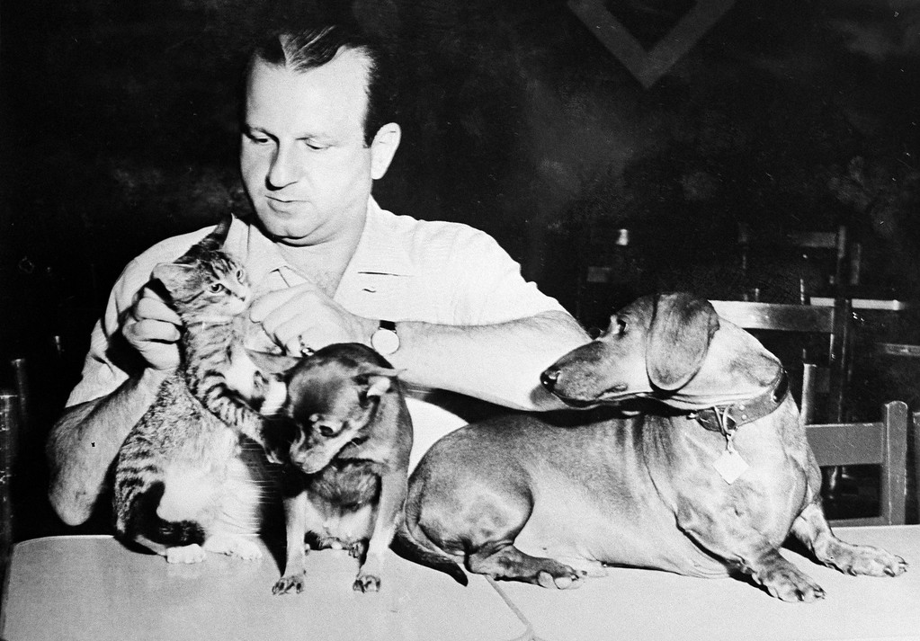 . File - Jack Ruby, Dallas nightclub owner, under indictment for the slaying of Lee Harvey Oswald, who accused of the assassination of U.S. President John F. Kennedy, is shown with his pets. This undated photo was on the wall of Ruby\'s office. (AP  Photo)