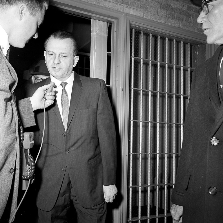 . Jack Ruby, convicted and sentenced to death for the slaying of Lee Harvey Oswald, was taken from his county jail cell in Dallas to Federal Court on a hearing whether the state or federal government should have jurisdiction on two points. Ruby is shown being interviewed as he leaves the county jail in Dallas, Texas, March 19, 1965. (AP Photo/Jim Bourdier)
