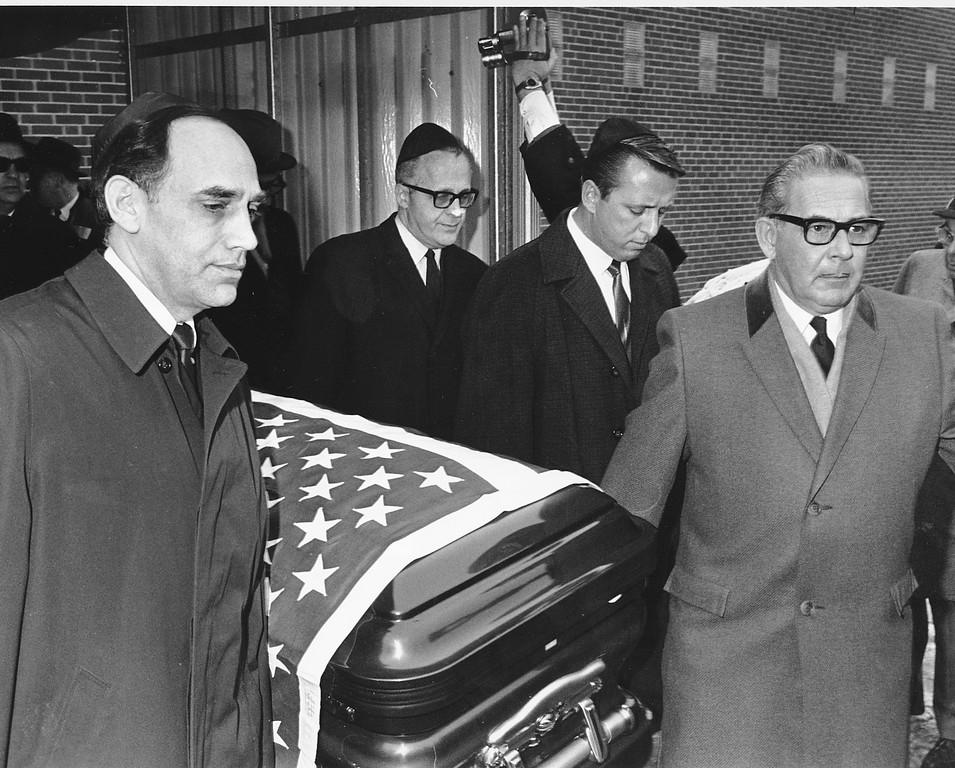 ". Pallbearers are seen carrying the flag-draped casket of Jack Ruby in Chicago, Ill., in Jan. 1967. A small gathering heard Rabbi David Graubert term Ruby as ""an avenger of blood--a misguided patriot.\"" Ruby, who was sentenced to death in 1964 for the murder of Lee Harvey Oswald two days after John F. Kennedy\'s assassination, died of cancer while awaiting retrial. At left is one of Ruby\'s lawyers, William Kunstler. (AP Photo)"