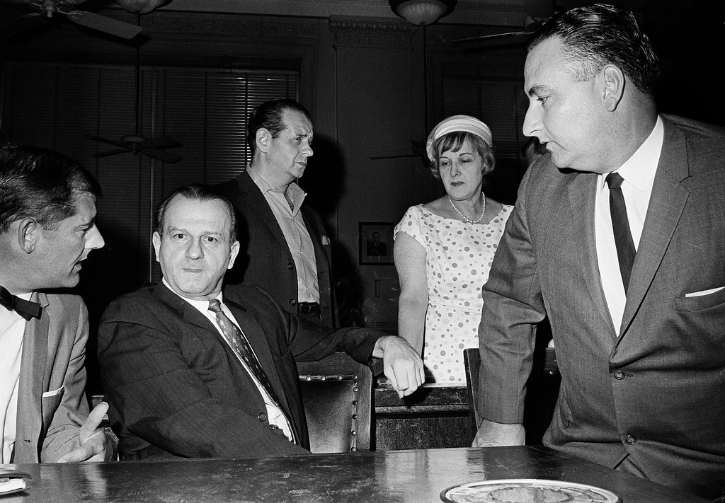 . File - Jack Ruby talks with defense attorney Sam Houston Clinton, Jr., left, July 24, 1965, after District Judge Louis Holland denied a defense motion for a hearing to disqualify Judge Joe B. Brown from further proceedings in the case in which Ruby was convicted and sentenced to death for the shooting of presidential assassin Lee Harvey Oswald. (AP Photo/Ferd Kaufman)