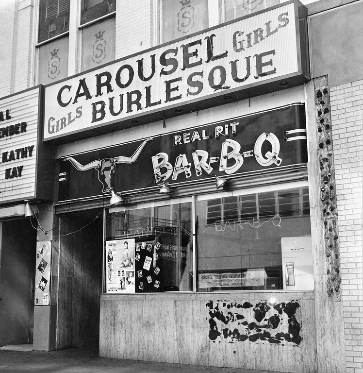 . The entrance and marquee of the Carousel burlesque club, located on the second floor on Commerce Street in Dallas, Texas, is shown on Nov. 24, 1963, on the day the club\'s operator Jack Ruby shot President Kennedy\'s accused assassin, Lee Harvey Oswald.  (AP Photo)