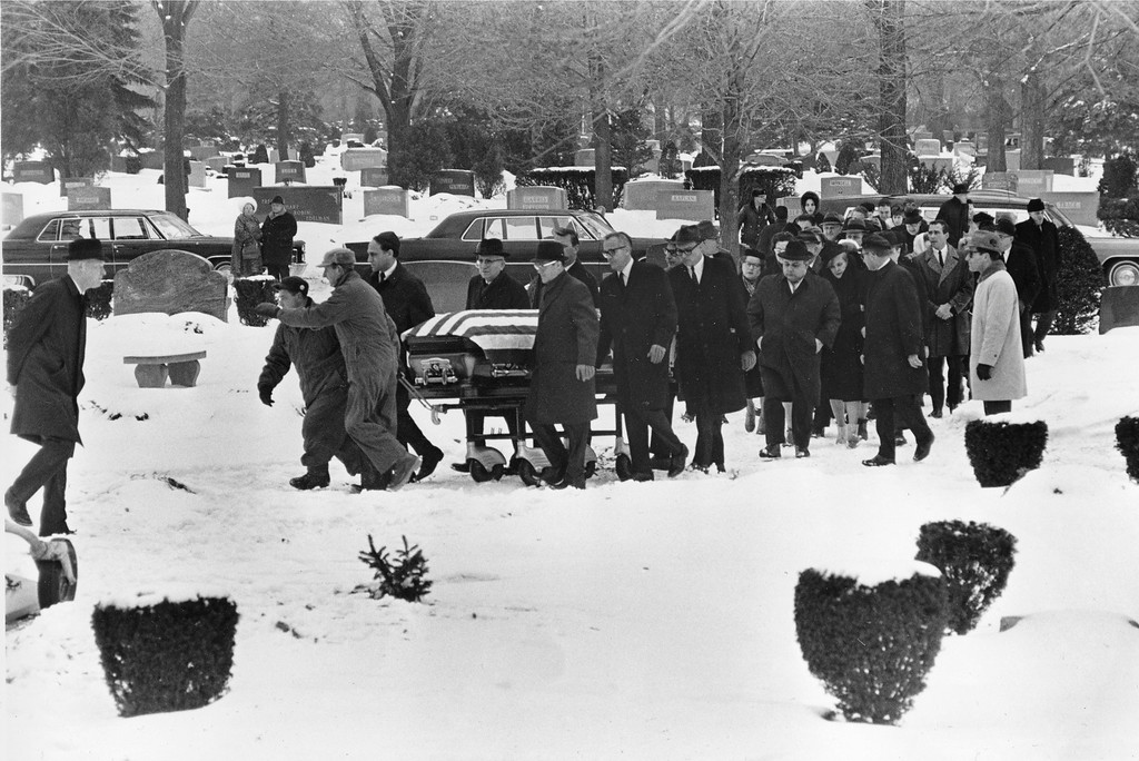 . Pallbearers, followed by family and friends, trundle the casket of Jack Ruby to his gravesite in the family plot in Westlawn Cemetery on Chicago\'s northwest side, Ill., Jan. 6, 1967.  The slayer of Lee Harvey Oswald was buried beside his parents.  (AP Photo)