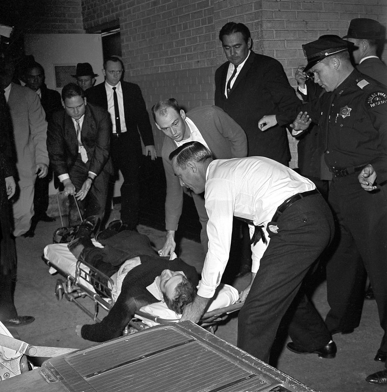 . FILE - In this Sunday, Nov. 24, 1963 file photo, Lee Harvey Oswald, accused assassin of President John F. Kennedy, is placed on a stretcher after being shot in the stomach in Dallas. Nightclub owner Jack Ruby shot and killed Oswald as the prisoner was being transferred through the underground garage of Dallas police headquarters. (AP Photo/David F. Smith)