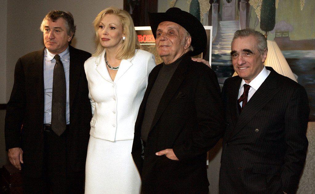 ". ""Raging Bull\"" cast members Robert DeNiro, left, and Cathy Moriarty, stand for a photograph with boxer and author Jake LaMotta, second from right, and filmmaker Martin Scorsese watching a 25th anniversary screening of the movie Thursday, Jan. 27, 2005 in New York. An anniversary collector\'s edition DVD of the film was also released.   (AP Photo/Julie Jacobson)"