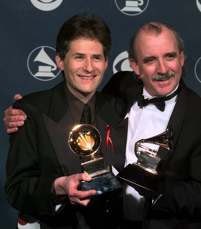 """. Songwriters James Horner, left, and Will Jennings hold up their award for song of the year, \""""My Heart Will Go On\"""" performed by Celine Dion, during the 41st Annual Grammy Awards at the Shrine Auditorium in Los Angeles Wednesday, Feb. 24, 1999.  (AP Photo/Reed Saxon)"""