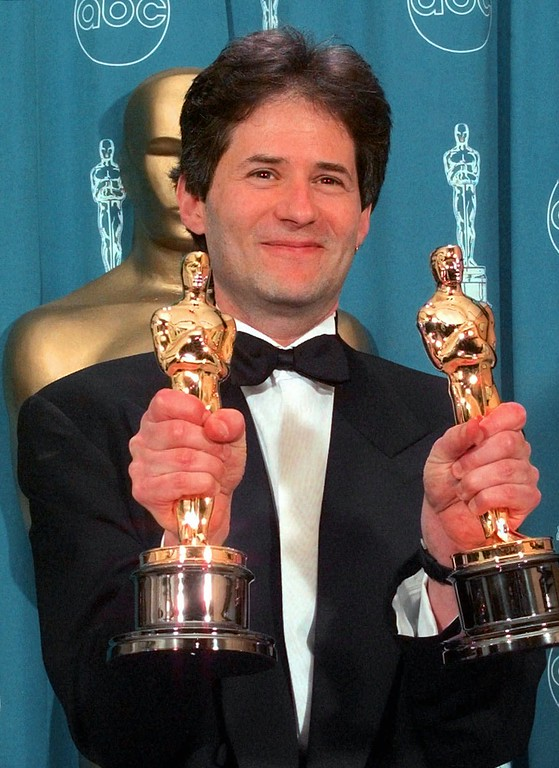 """. James Horner displays Oscars he won for Original Song and Original Dramatic Score for \""""Titanic,\""""at the 70th Academy Awards at the Shrine Auditorium in Los Angeles Monday, March 23, 1998.(AP Photo/Reed Saxon)"""