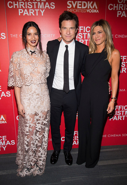 ". Olivia Munn, left, Jason Bateman and Jennifer Aniston attend a screening of ""Office Christmas Party\"", hosted by Paramount Pictures and The Cinema Society, at the Landmark Sunshine Cinema on Monday, Dec. 5, 2016, in New York. (Photo by Charles Sykes/Invision/AP)"