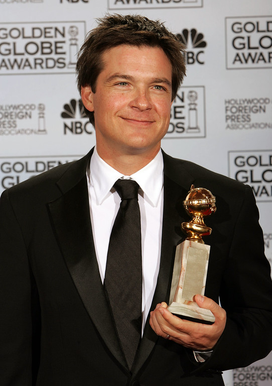 . Jason Bateman poses with the award he won for best actor in a musical or comedy series for his work on Arrested Development, at the 62nd Annual Golden Globe Awards on Sunday, Jan. 16, 2005, in Beverly Hills, Calif.  (AP Photo/Reed Saxon)