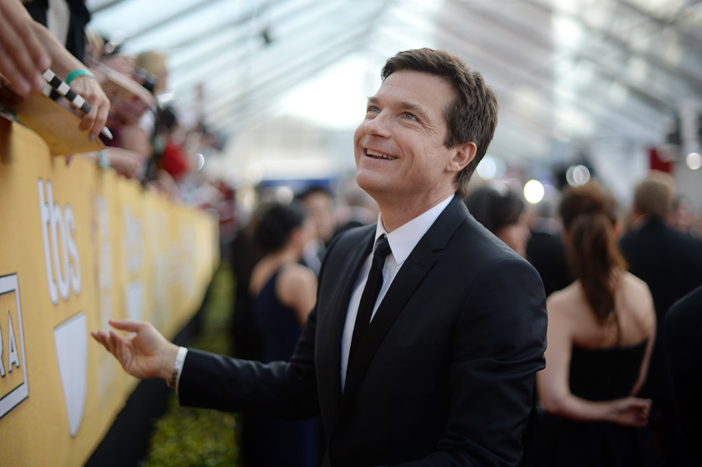 . Jason Bateman says hello to fans on the red carpet at the 20th Annual Screen Actors Guild Awards  at the Shrine Auditorium in Los Angeles, California on Saturday January 18, 2014. (Photo by Hans Gutknecht / Los Angeles Daily News)