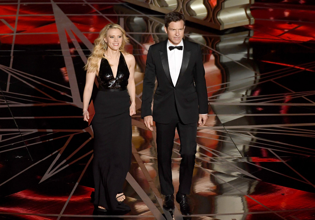 . HOLLYWOOD, CA - FEBRUARY 26:  Actors Kate McKinnon (L) and Jason Bateman walk onstage during the 89th Annual Academy Awards at Hollywood & Highland Center on February 26, 2017 in Hollywood, California.  (Photo by Kevin Winter/Getty Images)