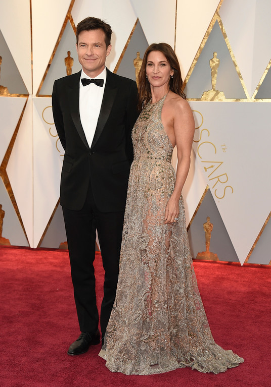 . Jason Bateman, left, and Amanda Anka arrive at the Oscars on Sunday, Feb. 26, 2017, at the Dolby Theatre in Los Angeles. (Photo by Jordan Strauss/Invision/AP)