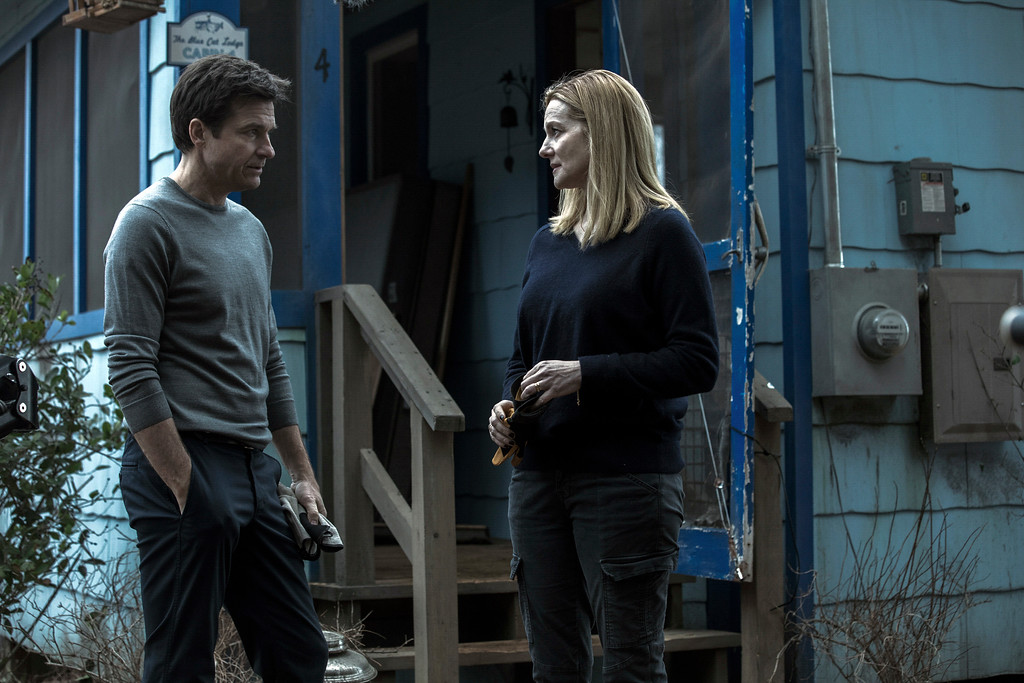 """. This image released by Netflix shows Laura Linney, right, and Jason Bateman in a scene from the series, \""""Ozark.\"""" (Jackson Davis/Netflix via AP)"""