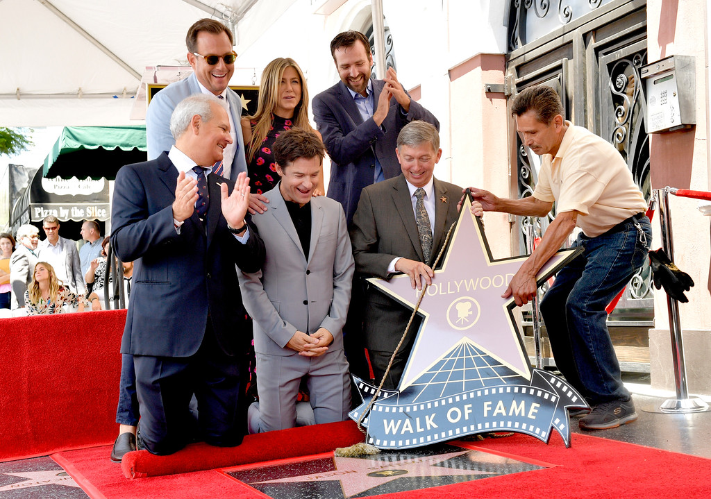 . HOLLYWOOD, CA - JULY 26:  (Top L-R) Will Arnett, Jennifer Aniston, Ben Allen, (Bottom L-R) Jeff Zarrinnam, Jason Bateman, and President & CEO Hollywood Chamber of Commerce Leron Gubler attend The Hollywood Walk of Fame Star Ceremony honoring Jason Bateman on July 26, 2017 in Hollywood, California.  (Photo by Matt Winkelmeyer/Getty Images)