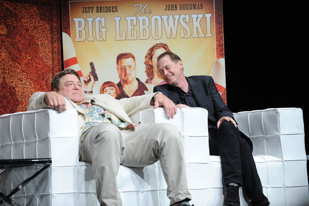 ". In this photograph taken by AP Images for Universal Studios Home Entertainment, John Goodman, left, and Steve Buscemi are seen during a Q and A at a cast reunion celebrating ""The Big Lebowski\"" Limited Edition Blu-ray release on Tuesday, Aug. 16, 2011, in New York. (Diane Bondareff/AP Images for Universal Studios Home Entertainment)"